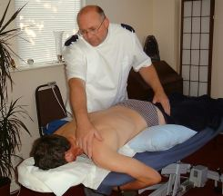 Phil Giving Spinal Touch Treatment. Gift Vouchers